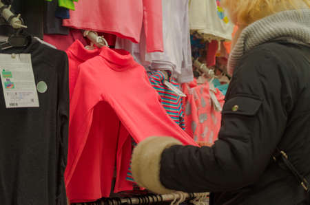 Blonde girl in a toy and clothing store