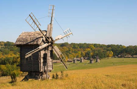 Old wooden windmill in autumns enviroment photo