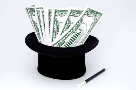 it is a magical hat and a magical varita of which they appear tickets of 5 dollars Stock Photo - 438542
