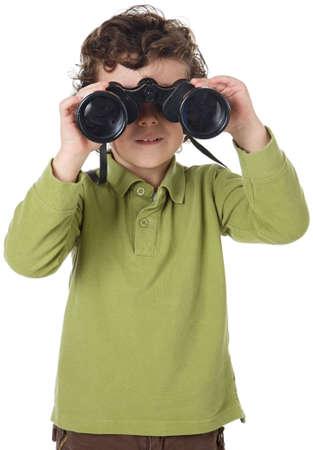 adorable boy watching with binoculars to the horizon Stock Photo - 684153