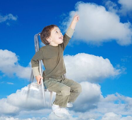 clouds making: adorable child over clouds making reality its dreams