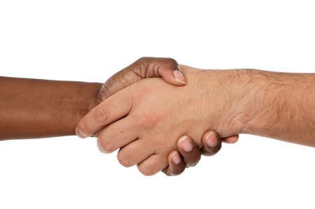 Handshake between races a over white background Stock Photo