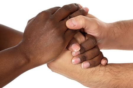 interracial relationships: Handshake between races a over white background Stock Photo