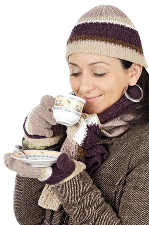 sheltered: photo of an attractive lady sheltered for the winter drinking a tea cup Stock Photo