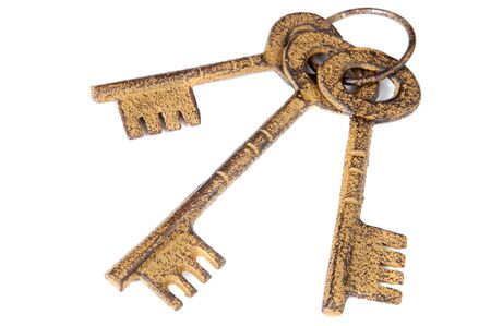 A photo of three keys a over white background photo