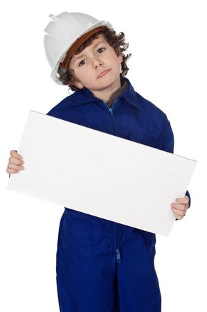 Adorable boy dressed worker whit billboard over white background photo