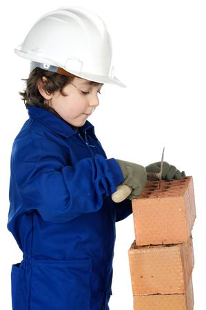 adorable future builder constructing a brick wall a over white background photo