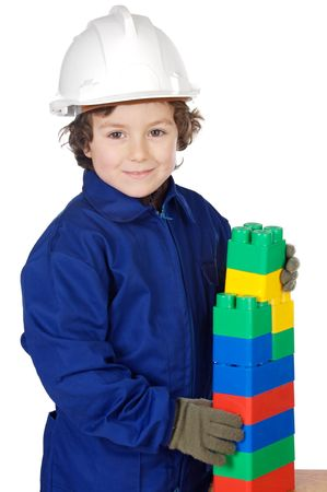 designer baby: adorable future builder constructing a brick wall with toy pieces a over white background