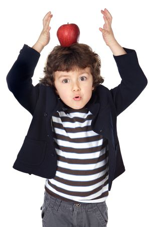 school children uniform: Adorable child with an apple in the head a over white background Stock Photo