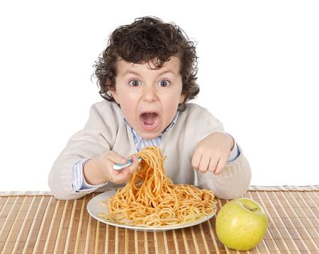 Adorable child hungry at the time of eating a over white background