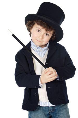 adivino: Adorable ni�o vestido con sombrero de ilusionista a en fondo blanco