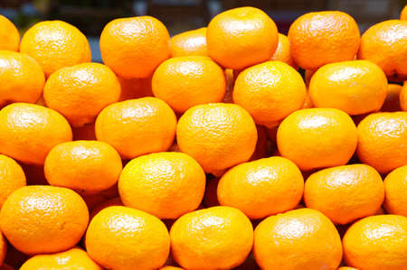 piled: oranges piled up in a store of fruits