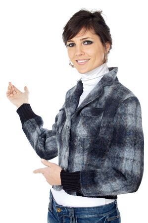 attractive and elegant business woman indicating the bottom with a hand over a white background photo