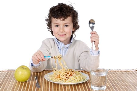 Adorable child hungry at the time of eating a over white background photo
