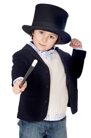 adivino: Vestido adorable del ni�o del illusionist con el fondo del blanco del excedente del sombrero a