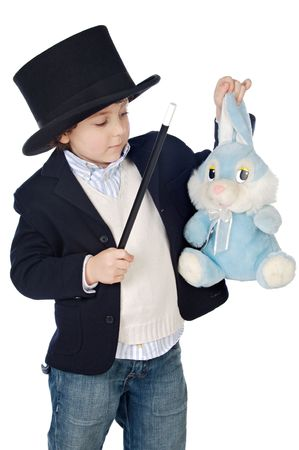 soothsayer: Adorable child dress of illusionist with hat a over white background