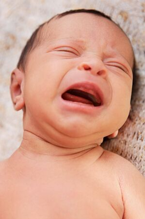 unhappiness: adorable new born baby crying Stock Photo