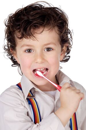 adorable boy  child cleaning the teeth a over white background