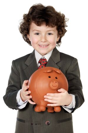 adorable child with its savings in its moneybox of piggy a over white background photo