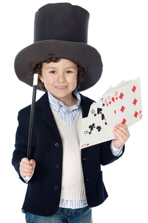 magicians: Adorable child dress of illusionist with hat a over white background