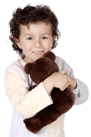 adorable child prepared to sleep with its bear a over white background photo