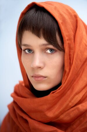 sheik: attractive woman with veil in the head a over blue background Stock Photo