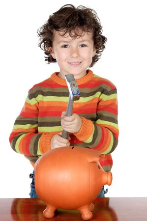 photo of an adorable boy breaking the money box photo