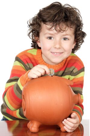 money box: adorable boy putting its savings in your money box Stock Photo