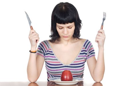 anorexia girl: girl watching a red apple to over white background