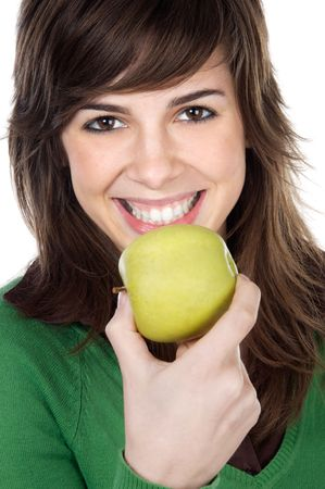 attractive girl eating a green apple a over white background Stock Photo - 906862