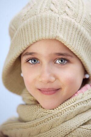 precious face of an adorable girl a over blue background Stock Photo