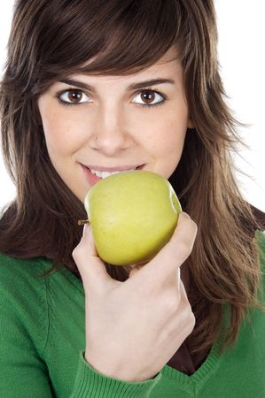 thinness: attractive girl eating a green apple a over white background