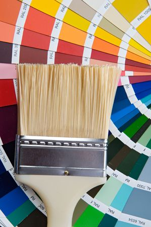 photo of Paintbrush with card of colors photo