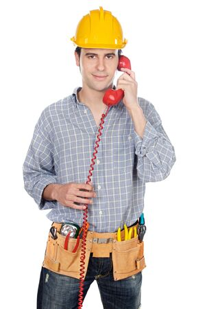 Construction worker talking on the phone a over white background Stock Photo