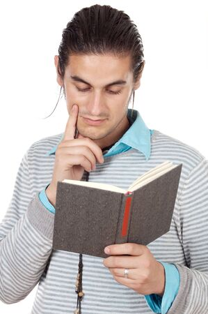 attractive boy reading a book over white background photo