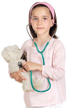 Little doctor examining her bear a over white background photo