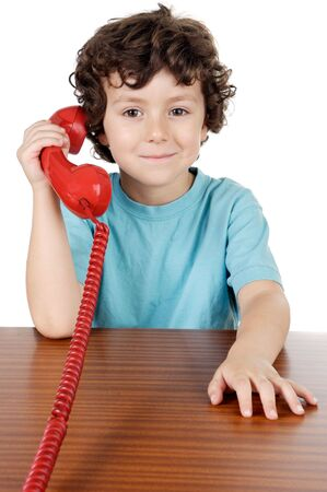 Child speaking on the telephone a over white background