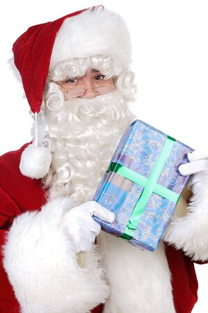 Santa Claus with a gift a over white background photo