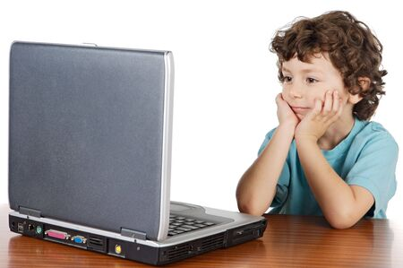 Child whit laptop a over white background photo