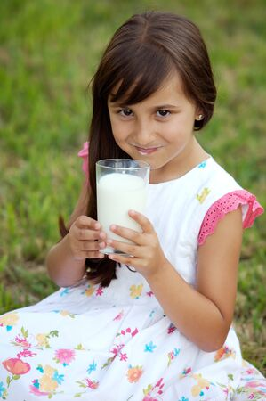 pasteurized: photo of a adorable girl drinking milk