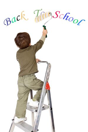 broach: photo of an adorable boy painting the text back to school a over white background