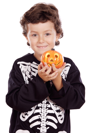 skeleton costume: ADORABLE BOY DISGUISED IN HALLOWEEN a over white background