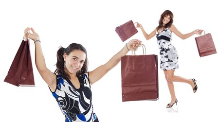 Two shopping young girls a over white background Stock Photo - 1684366