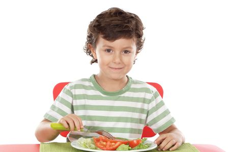 small plate: Healthy child eating  a over withe background Stock Photo