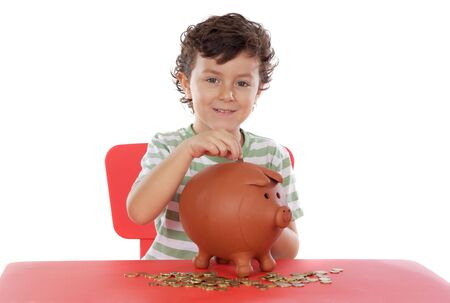 thrift box: adorable boy putting its savings in your money box Stock Photo