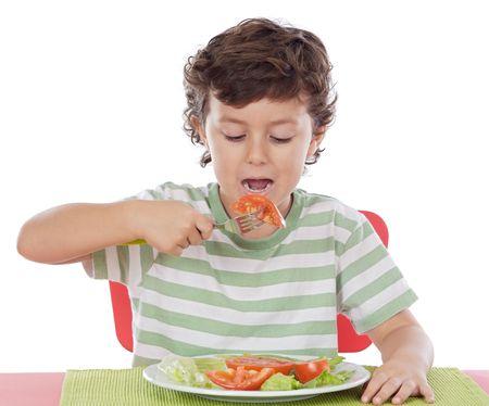 alimentacion balanceada: Ni�o sano comer a en la dieta equilibrada con antecedentes  Foto de archivo