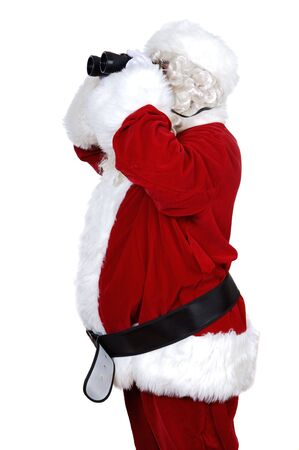 santa claus with binoculars a over white background photo