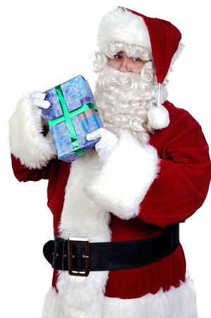 Santa Claus with a gift over white background photo