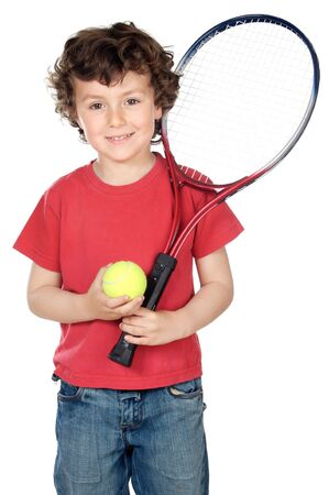 tennis racket: Young boy with tennis racket and ball