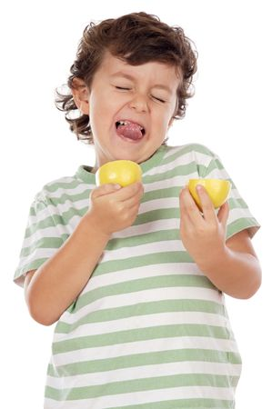 Cute boy eating lemon over a white background Stock Photo